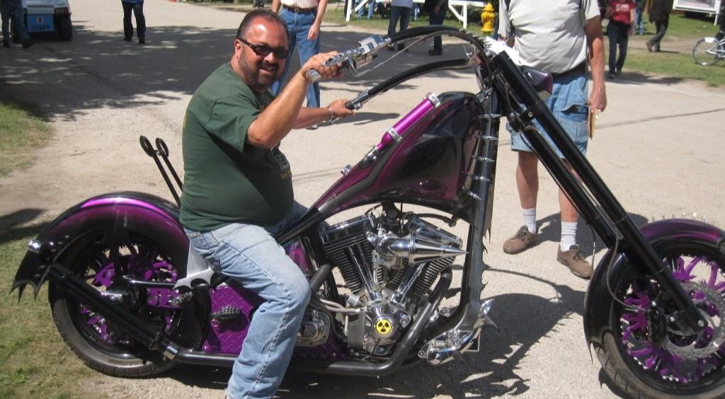 Frank Fritz smiling while posing on his stylish bike
