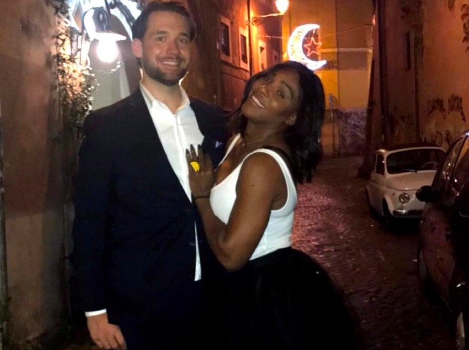 Serena Williams with her finace Alexis Ohanian. The tennis pro has kept her one hand on Alexis's chest as she flashes her huge engagement ring.