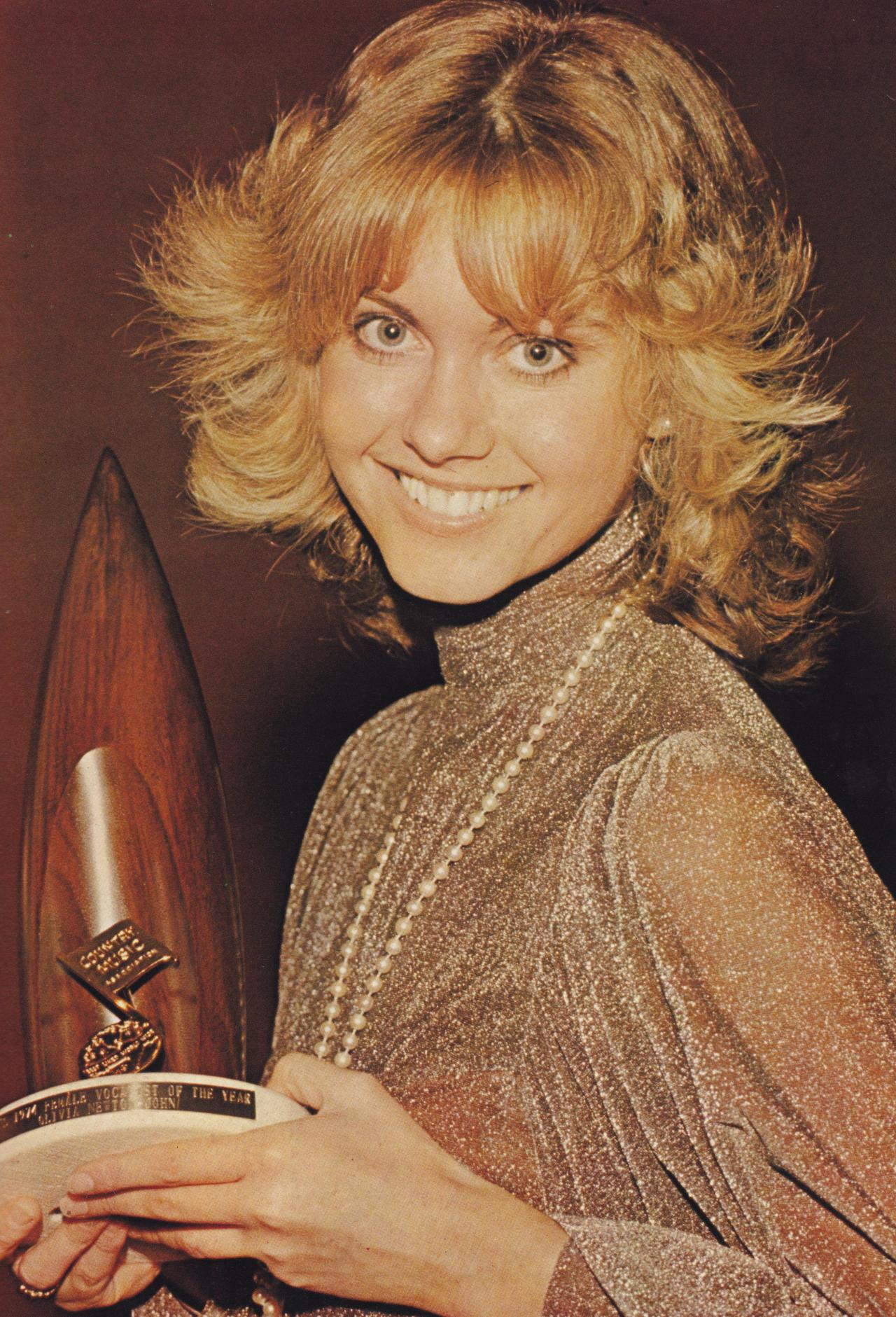 Singer Olivia Newton John at the Country Music Association Awards CMA Awards 1974. Olivia Newton John has released 28 studio albums, six live albums, seventeen compilations and four soundtracks