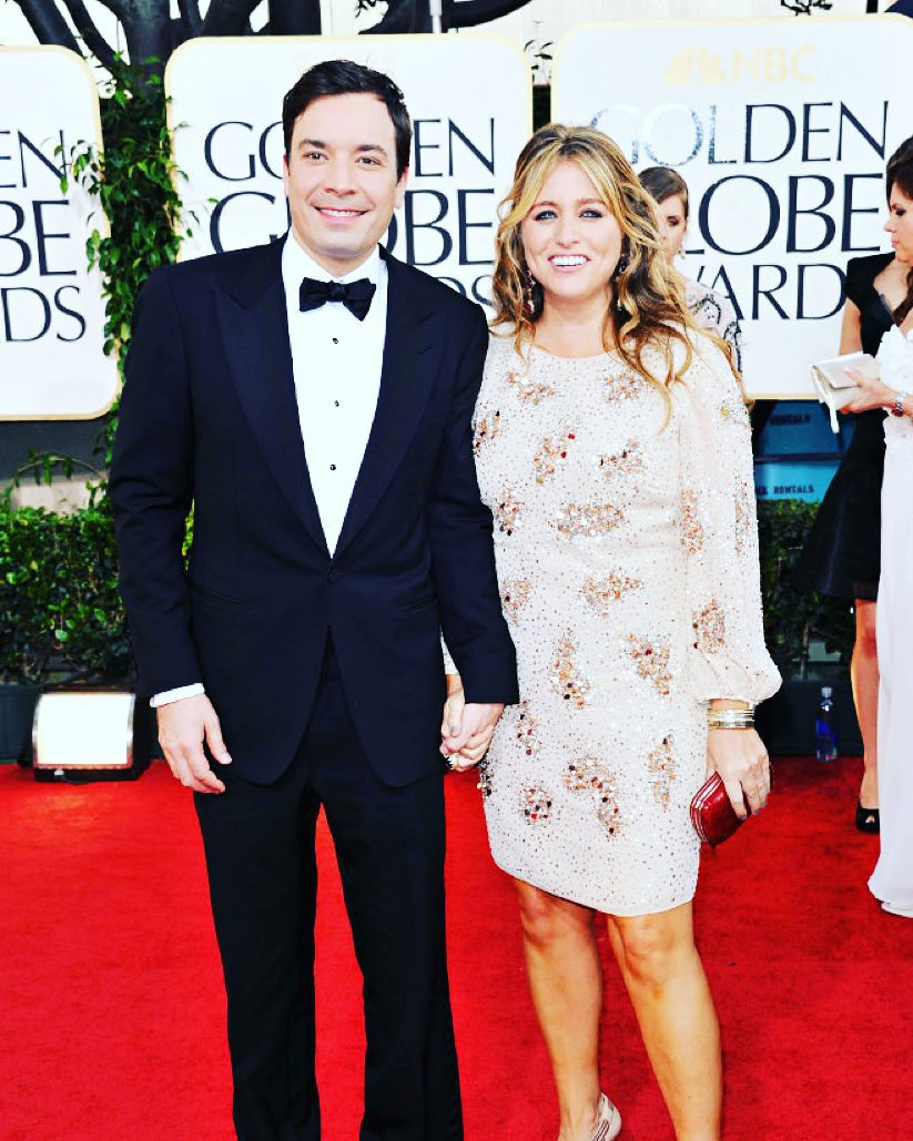 Jimmy Fallon and wife Nancy Juvonen holding hands at a red carpet