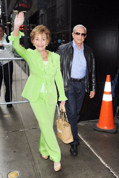 Judy Sheindlin waving at her fans. She is out with her husband, the couple look adorable.