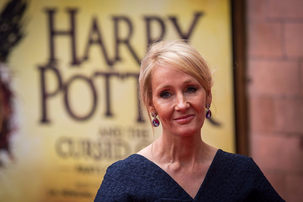 J.K. Rowling poses for a picture in front of the Harry Potter: The Cursed Child book's picture