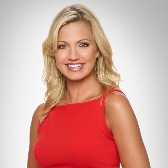 Sportscaster Michelle Beadle's giving a delightful smile. She looks much beautiful in red dress