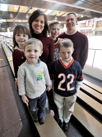 Amy Freeze and husband Gary are with their children at the ice skate rink. Amy and Gary share four children together.