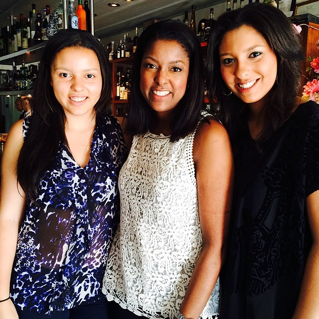 From left to right: Lori Stoke's younger daughter Nicole, Lori Stokes, and her elder daughter Alexandra.