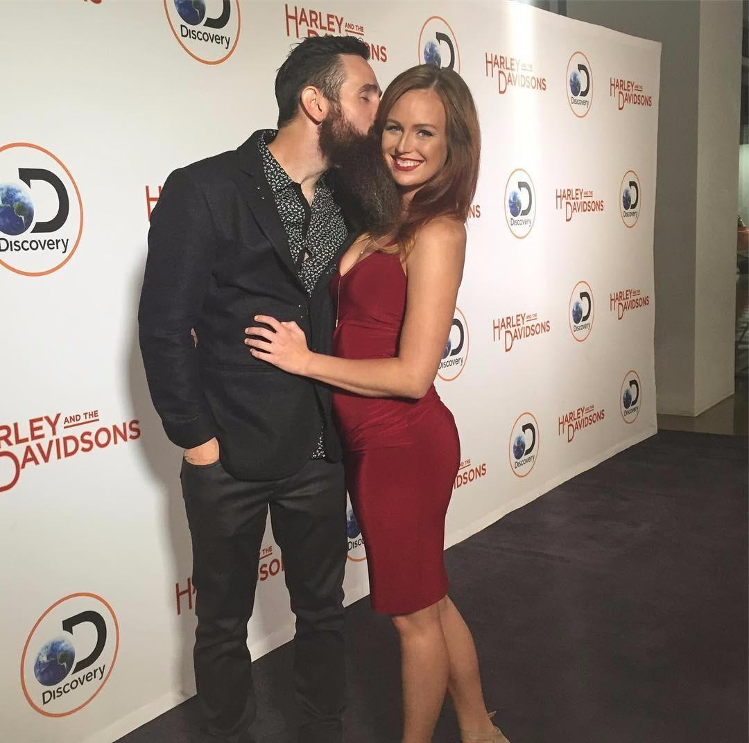 Aaron Kaufman kissing his girlfriend