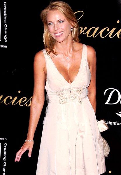 Laura Logan wearing a white dress