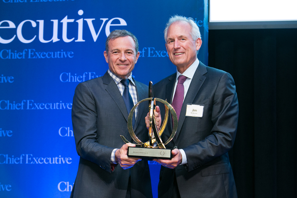 Bob Iger receiving Best CEO Award from JIm McNerey , CEO for Boeing Company.