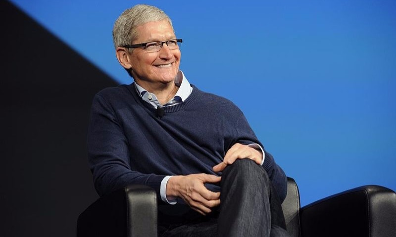 Tim Cook looks charming in his sweater and former wear