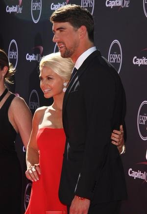 Win McMurry and her then boyfriend Michael Phelps posing for a camera during ESPY Night Awards.