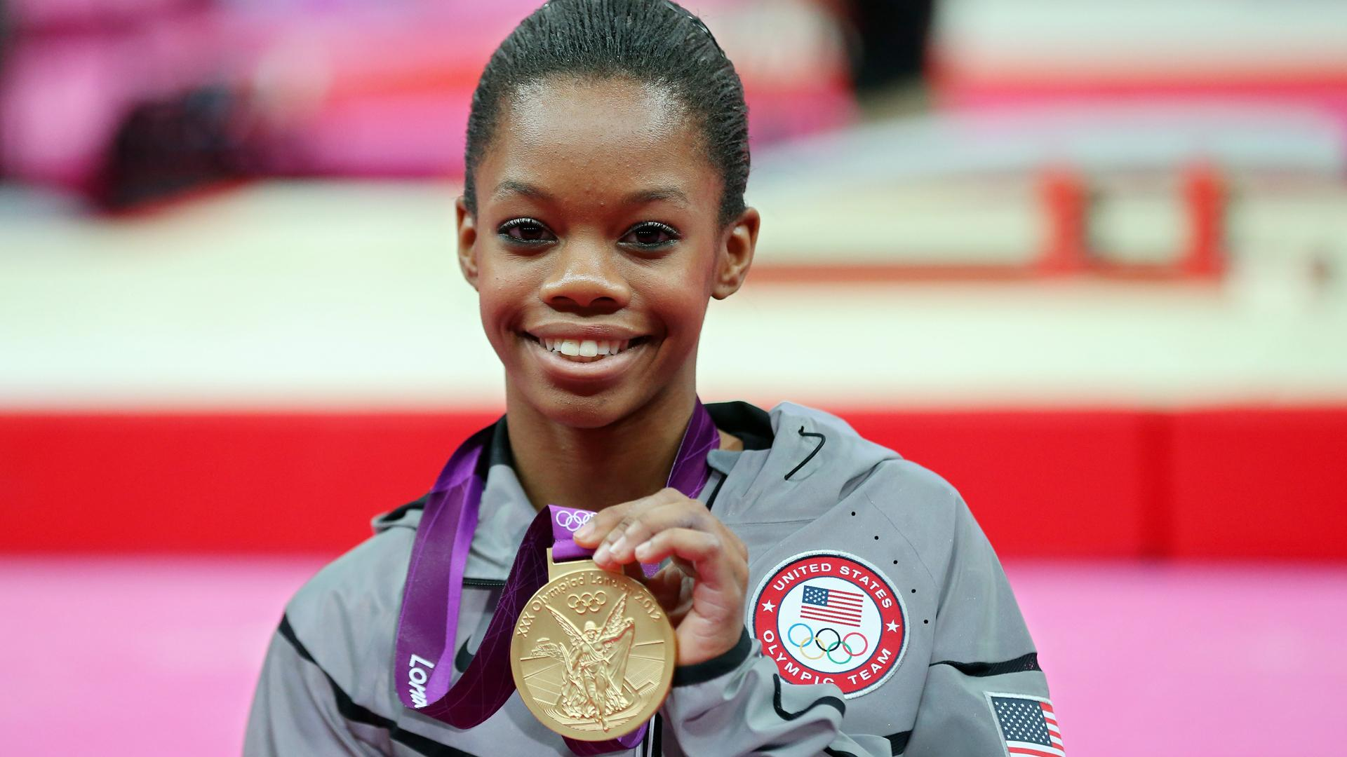 Gabby Douglas poses with her gold medal at the 2012 Olympics, London,