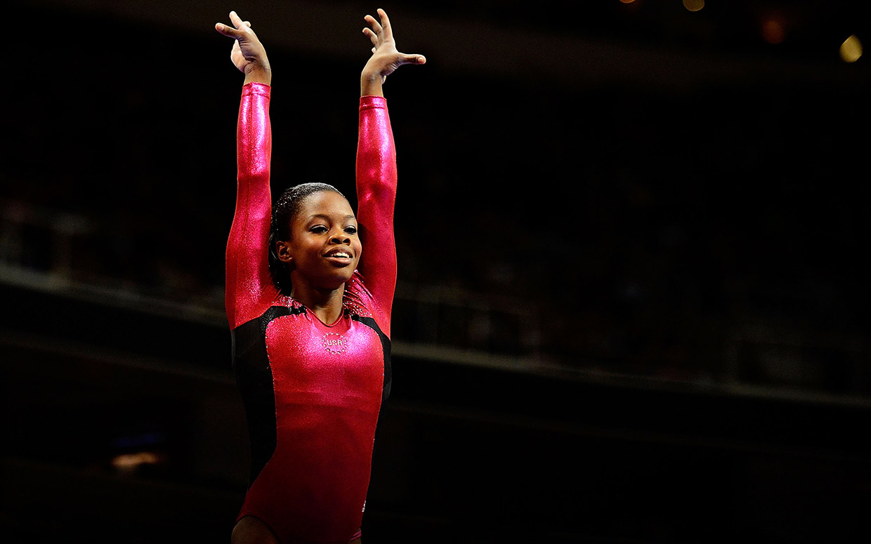 Gabby Douglas finishes off a gymnastic routine in Olympic Trials in 2012