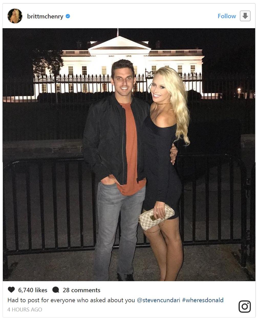 Britt McHenry standing next to her boyfriend Steven Cundari, who is holding her by her waist.