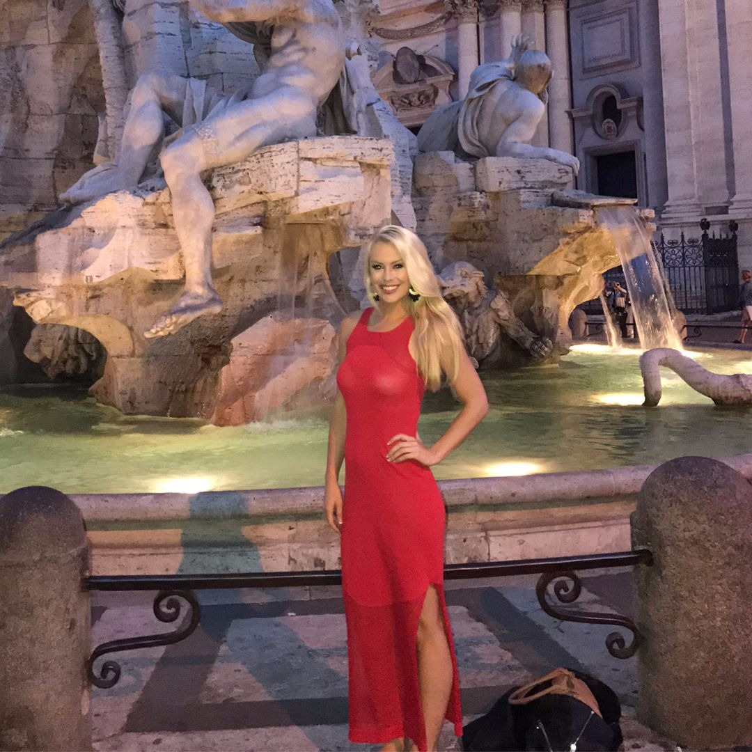 Britt McHenry flaunting her hot body in the red figure-hugging dress