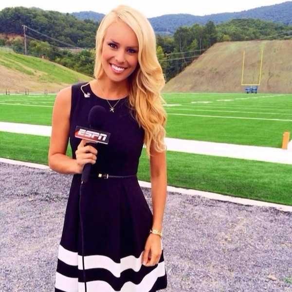 Britt McHenry looks stunning in the black dress as she poses for the camera with a beautiful smile on face and holding a mic on right hand
