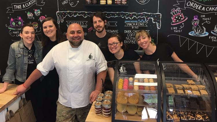 Duff Goldman with his staffs of Charm City Cakes