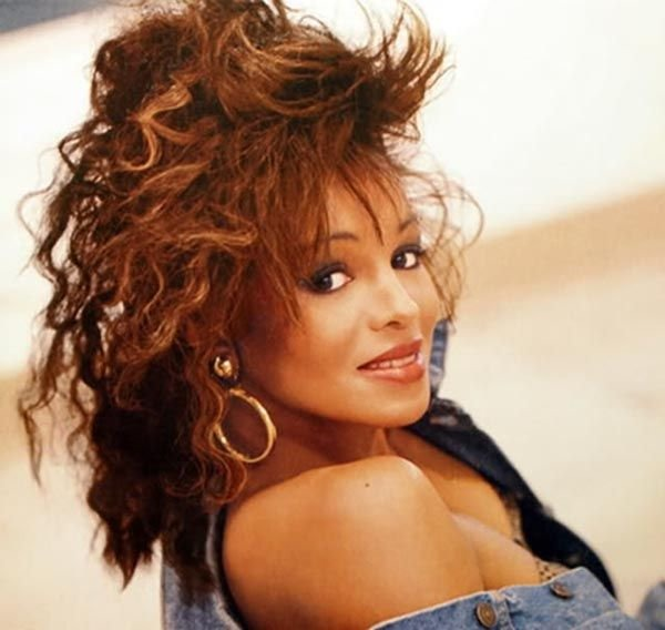 Rebbie Jackson playing coy with the camera. She is wearing one side off shoulder jeans shirt. She is the eldest sister of late singer Michael Jackson.