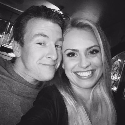 Black and white image of A. J. Allmendinger and his girlfriend Tara Meador who is sharing a big smile