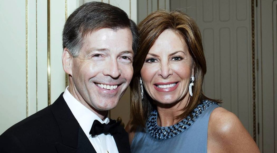 Kathy Brock and her husband, Douglas P. Regan  sharing a smile