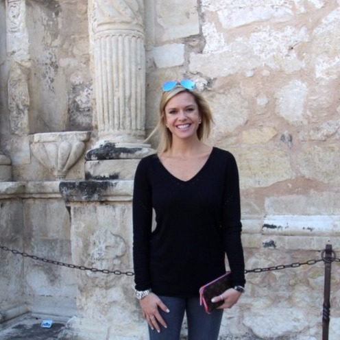 Kathryn Tappen standing behind The Alamo, the shrine of Texas liberty!