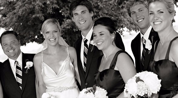 Kathryn Tappen and husband Jay Leach smiling in their wedding attire, there are two other men and two bridesmaids around them