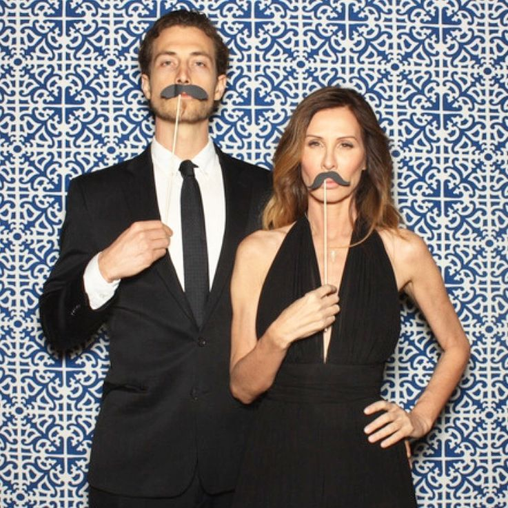 Carole Radziwill and her then boyfriend Adam Kenworthy posing with moustaches