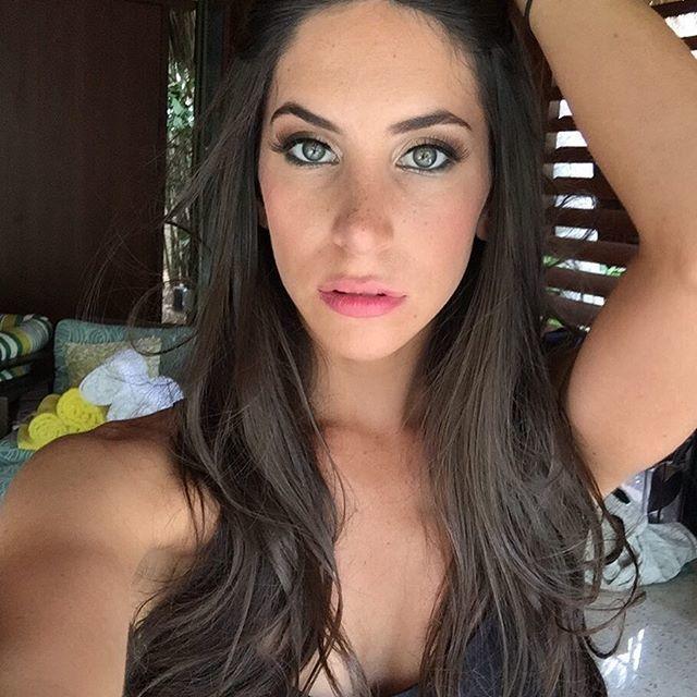 Jen Selter selfie, her hair is falling over her shoulders