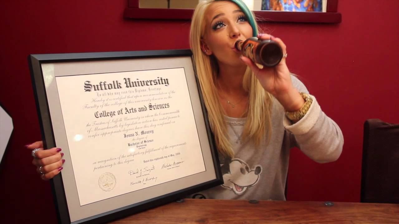 Jenna Marbles is holding her college degree with one hand while drinking beer from the bottle with her other hand.