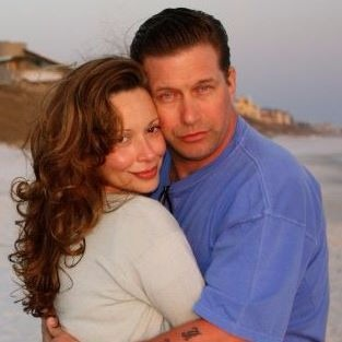 Kennya Baldwin is hugging her husband Stephan Baldwin. They look cozy together, spending quality time by the ocean. Kennya's wavy hair looks perfect with her smile.