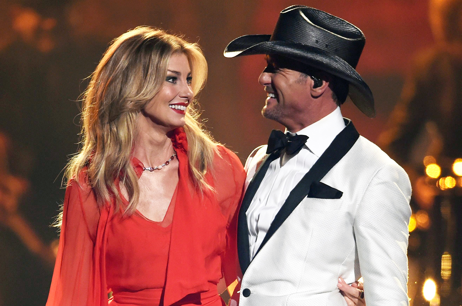 Tim and faith looking at each other