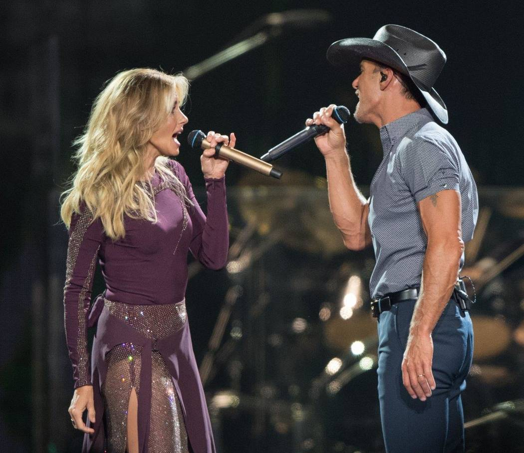 Faith and Tim singing on a stage