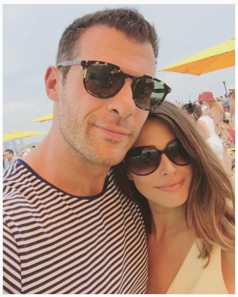 Michael Craig snaps a selfie with Jennifer Lahmers on a beach