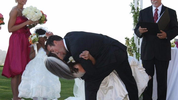 Fox 5 journalist Jennifer Lahmers was lovingly kissed by her husband Jamie Bosworth after he was given permission to kiss the bride. Tyra Harris covers her eyes in modesty.