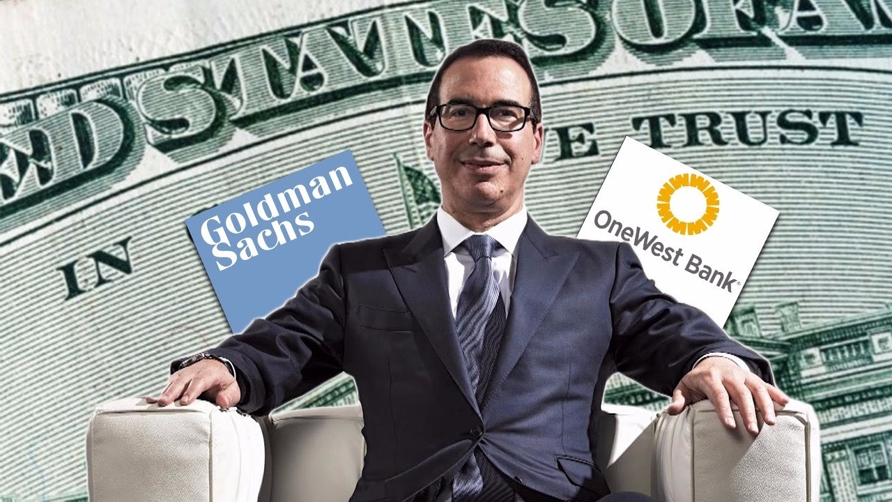 Steven Mnuchin sitting in sofa and posters of Goldman Sachs and OneWest Bank are stuck behind