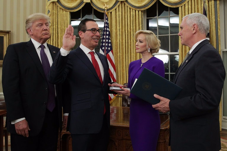 Steven Mnuchin standing aside President Donald Trump and then-fiance Louise Linton while swearing as US Treasure Secretary on February 13, 2017.