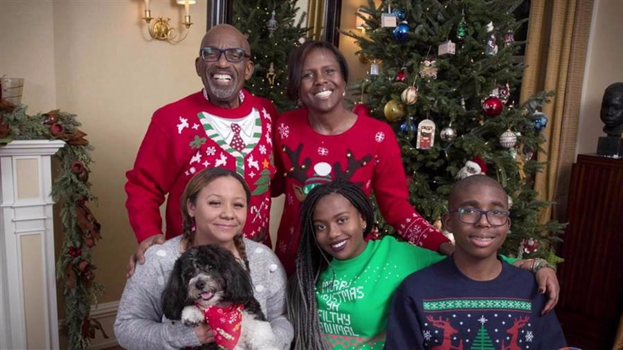Al Roker and Deborah Roberts with three children. The one, holding a dog is Courtney Roker, whom Al adopted with his first wife.
