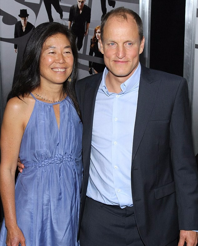 Woody Harrelson with his arm around his wife Laura Louie