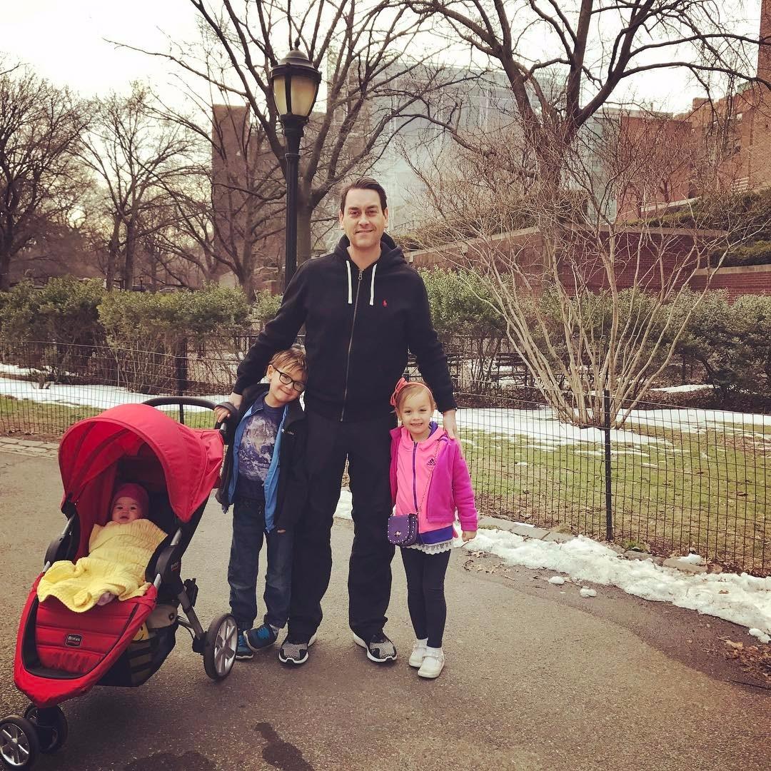 Clayton Morris in between his older children, his youngest is in a stroller