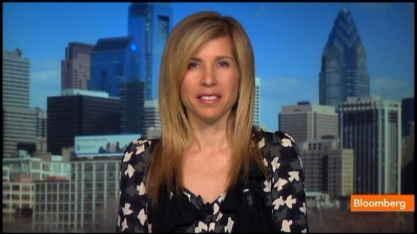 Lori Wachs on the set of Bloomberg News, there's a skyline behind her