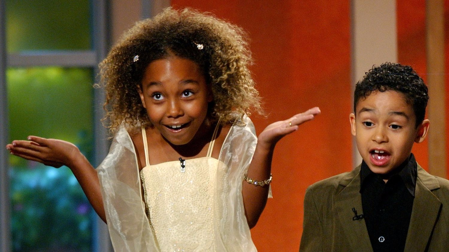Parker Mckenna Posey captured acting when she was of age 5, she is wearing a white skirt and is giving a surprised expression.