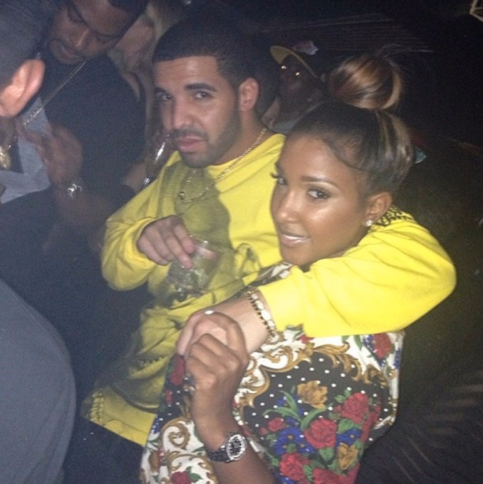 Drake, rapping his hands on then-girlfriend Bernice Burgos