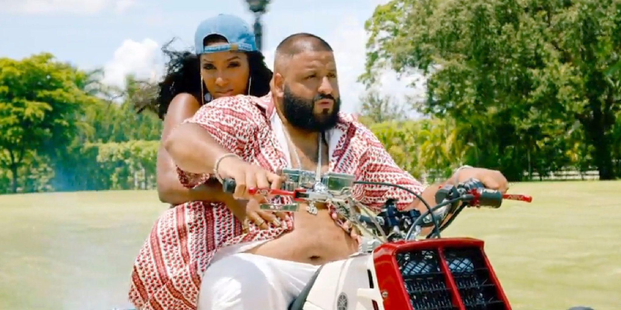 Bernice Burgos taking a ride with DJ Khaled on a bike
