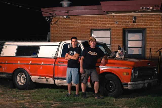 Farmtruck and AZN stands by the side of  his 1970 Chevy long bed truck,