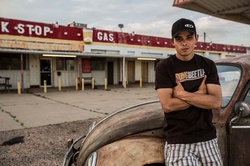 Jeff Bonnett aka AZN is standing in front of a car