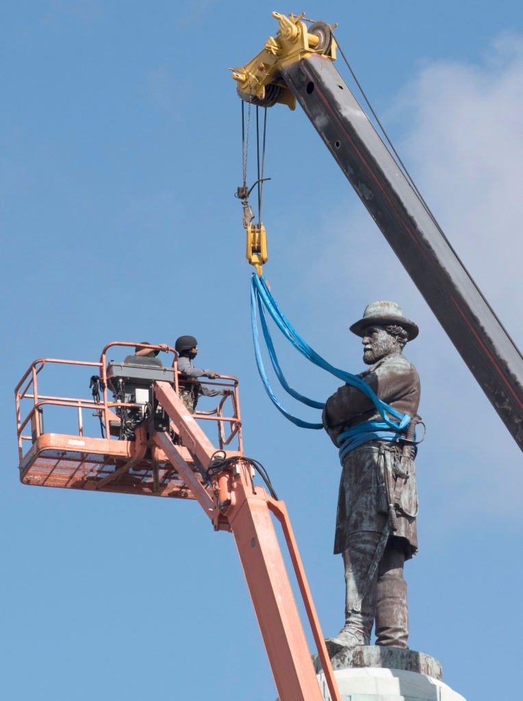 The Confederate statue of Gen. Robert E. Lee being removed