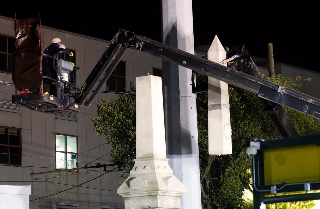 The Confederate figures standing in the New Orleans, Lousiana being removed