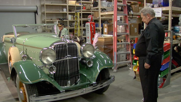 """Richard """"The Old Man"""" Harrison have a glance at 1932 Lincoln Roadster."""