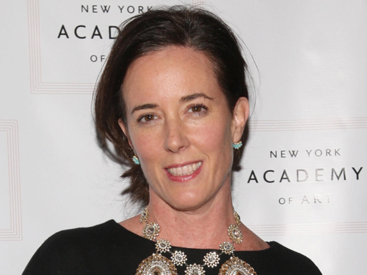 Kate Spade posing with a smile on her face