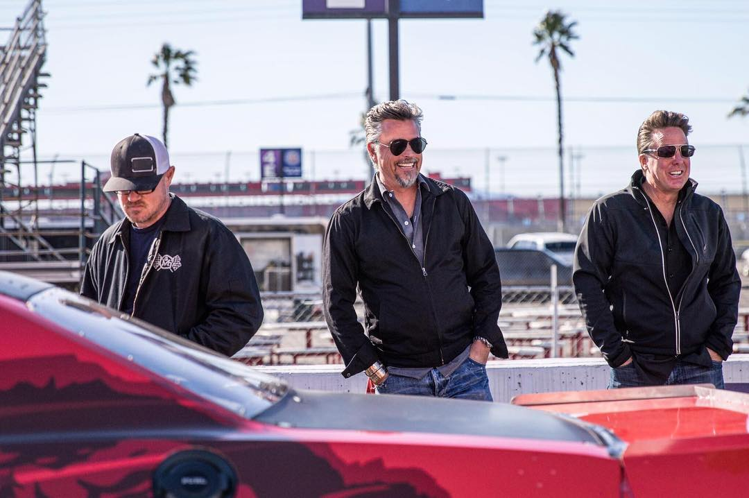 Richard Rawlings, his friend Dennis Collins and GMG's one of the crew members standing behind the red car