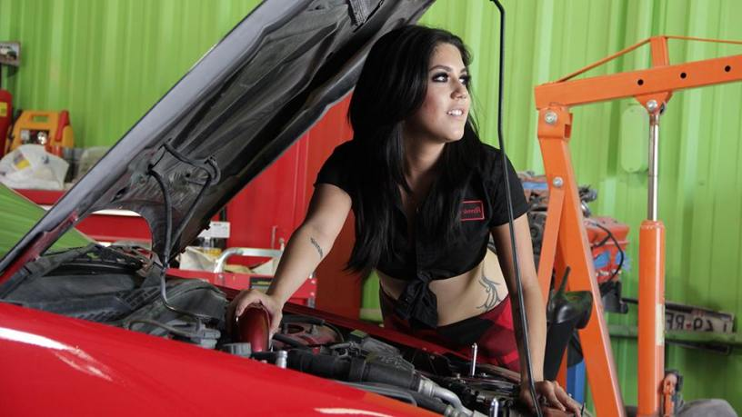 A girl checking the cars' condition